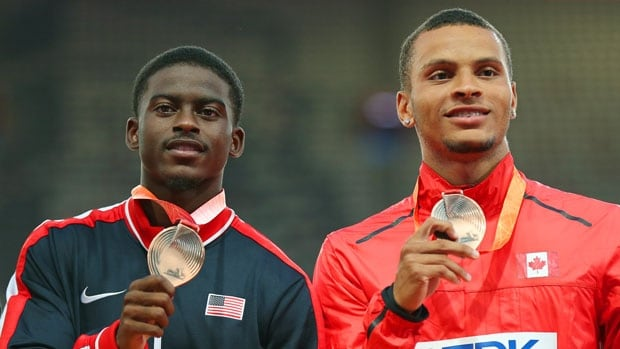 Andre De Grasse, right, became the first Canadian to win a medal in the men's 100m at the world championships since Bruny Surin in 1999. (Wu Hong/EPA)