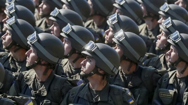 Members of the National Guard march during Ukraine's Independence Day military parade in the centre of Kyiv, Ukraine, on Monday. President Petro Poroshenko said Ukraine was facing a precarious year, warning that Russia had several strategies to undermine Kyiv's attempts to move towards Europe.