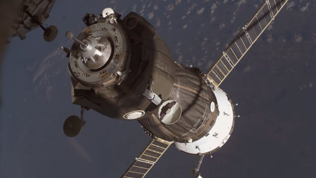 A Soyuz spacecraft carrying three astronauts and a load of supplies docks at the International Space Station. Since 2013, the trip from Earth in the cramped spacecraft has taken 6 hours. However, the next trip will take two days.