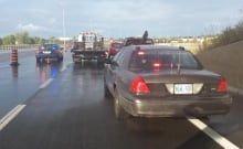 Crash collision Highway 417 Ottawa tow truck driver operator struck OPP Aug 26 2015