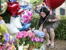 Flowers are seen at a memorial outside of the offices for WDBJ7 where slain journalists Alison Parker and Adam Ward worked in Roanoke, Virginia.