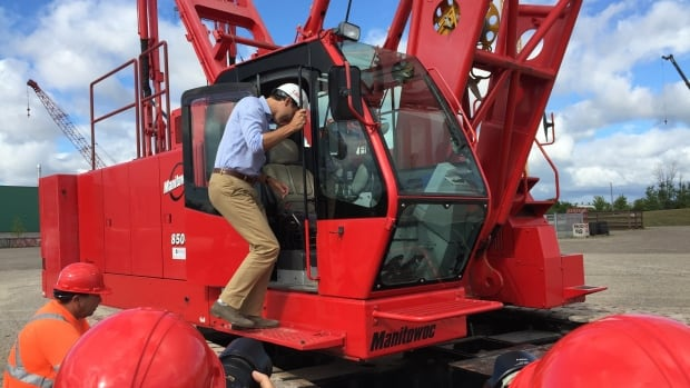 Justin Trudeau climbs into a crane in Oakville, Ont., ahead of a major infrastructure announcement last year. During the election campaign, the he pledged to double infrastructure spending if elected.
