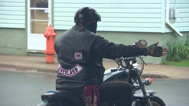 A biker wearing colours in the north-end of Halifax Aug. 27, 2015. The expansion of the Gate Keepers to six chapters is part of a rising Hells Angel's influence in Nova Scotia.