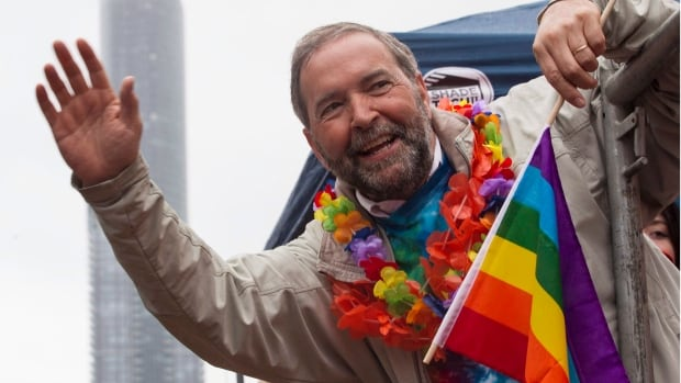 Federal NDP Leader Thomas Mulcair waves from a float during Toronto's Pride Parade on June 28, 2015. Canadians still have some basic questions about Mulcair despite his rise in the polls. According to Google Canada, the most asked question is: Who is Tom Mulcair?