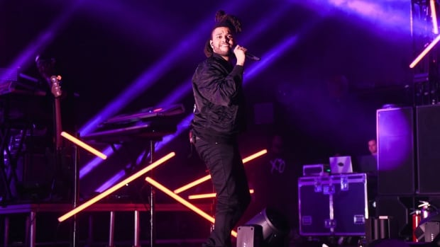 "Recording artist The Weeknd performs at the 2015 Billboard Hot 100 Music Festival at Nikon at Jones Beach Theater on Saturday, Aug. 22, 2015, in Wantagh, N.Y. From start to finish — quite literally — the Weeknd's hulking smash ""Beauty Behind the Madness"" features the handiwork of Canadian songwriter Stephan Moccio. THE CANADIAN PRESS/Scott Roth/Invision/AP"