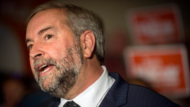 NDP Leader Tom Mulcair talks to supporters and the press as he takes his campaign to the new federal riding of Notre-Dame-de-Grace-Westmount, in Montreal, on Friday, August 28, 2015.