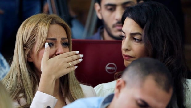 Marwa Fahmy, wife of journalist Mohamed Fahmy, bursts into tears at hearing the three-year prison sentence for her husband on Aug. 29. She has been front and centre in efforts to get Fahmy back to Canada.