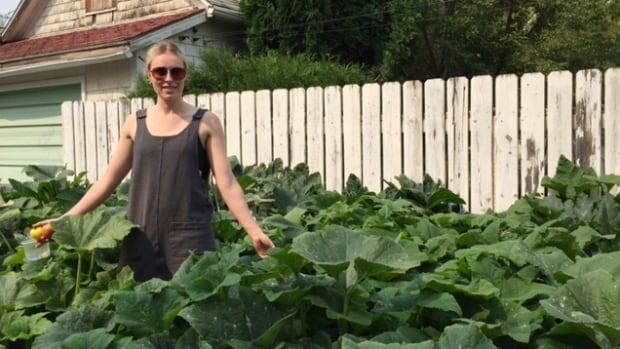Chef Christie Peters stands amongst a healthy crop of squash in her urban garden.