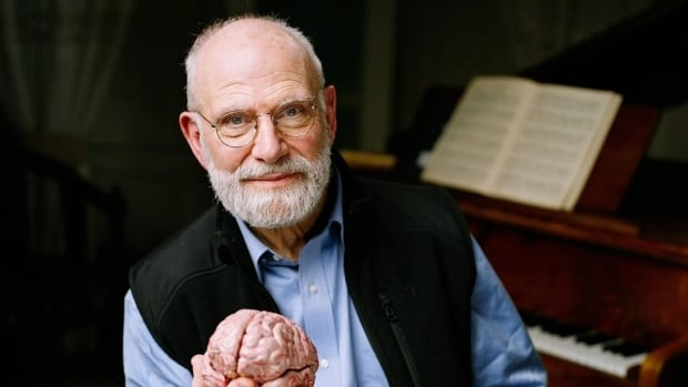 In this 2007 photo provided by the BBC, neurologist Oliver Sacks poses with a model of a brain at University College London in London. Sacks died on Sunday at the age of 82, the New York Times reported.