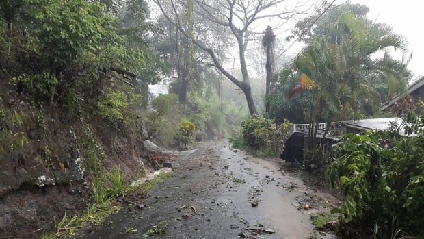 Debris covers a road after heavy rains from Tropical Storm Erika hit the Caribbean island of Dominica.