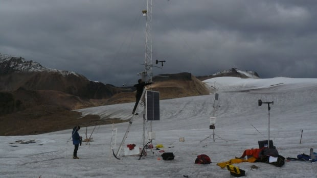 Graduate student Eric Courtin works on Atkinson's weather station - re-erected - in Nahanni National Park Reserve. Atkinson is researching how events like major storms can effect glacial melt, a study that he says could have repercussions on things like the changing water levels on the Mackenzie River.