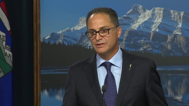 Alberta's NDP Finance Minister Joe Ceci says the province now expects to run a $5.9-billion deficit this fiscal year as the slumping price of oil forces downward revisions to fiscal estimates.