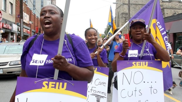 Health care workers take part in a Labour Day Parade in the streets of Ottawa in 2013.