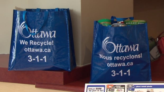 These blue reusable plastic bags are available for free for residents who want them.