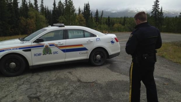 Whitehorse RCMP block Miles Canyon Road while searching for clues into the death of Christopher Brisson in 2015.