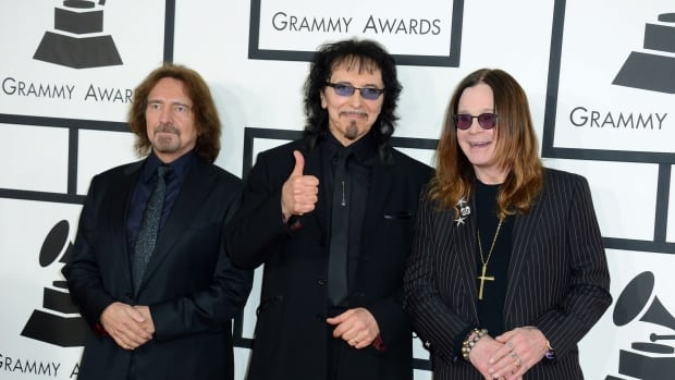 From left: Geezer Butler, Tony Iommi and Ozzy Osbourne of Black Sabbath arrive at the 56th annual Grammy Awards in Los Angeles in 2014.