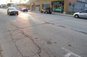 University Avenue West, cracks in road