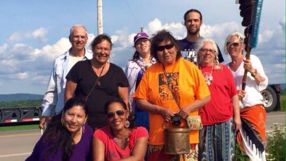 Tasha Beeds (bottom right) on the 2015 Sacred Water Walk, stopping just outside of Quebec City. Also in photo, Liz Osawamick,  Jerry, Elizabeth Brass Elson, Danielle LeBlanc, Josephine Mandamin, Nelson Footman, Monique Mathieu, Michele (Eagle Staff Holder).