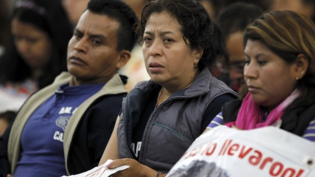 Family members of some of the 43 missing students from the Ayotzinapa teachers' training college attend a report presentation by members of a team of international experts in Mexico City  on Sunday.