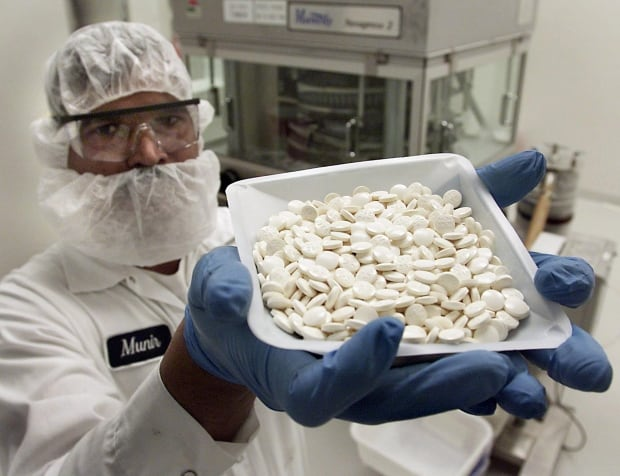 The global drug manufacturing supply chain is so complex, it's difficult to track the origins of a particular medication. (Kevin Frayer/Canadian Press)