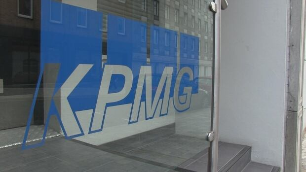 Four senior executives from the Belfast office of international accountancy firm KPMG have been arrested on tax evasion charges, but it is not known if the charges relate to their personal taxes or work on behalf of clients.