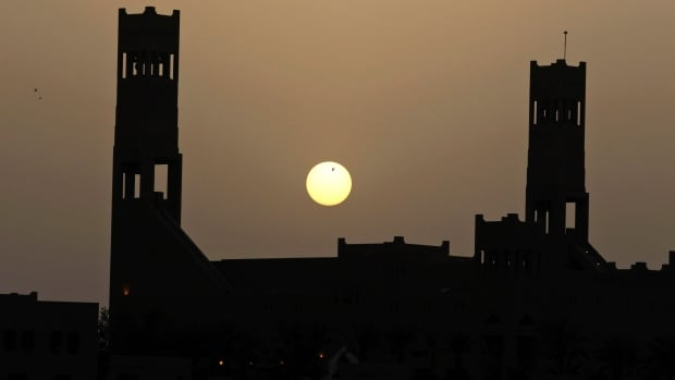 The sun sets over an old Saudi archaeological palace in Al-Diriyah city on the northwestern outskirts of the Saudi capital Riyadh. The IMF has warned the kingdom on its public finances as crude prices are low.