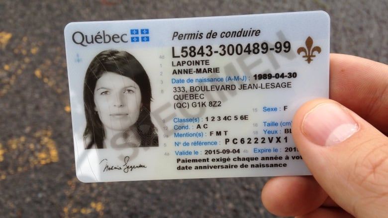 Quebec drivers' licences go black and white as part of
