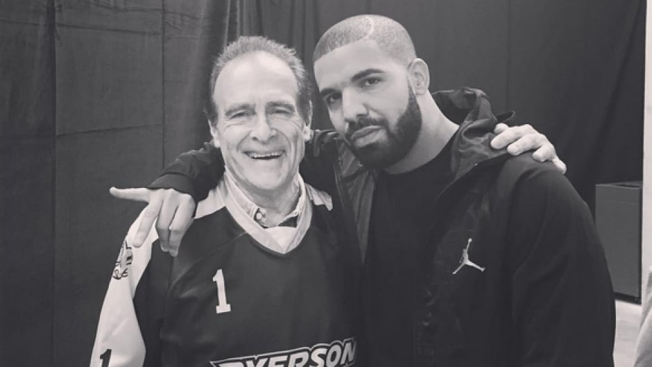 Drake and Norm Kelly posed for a photo after the hip hop star's surprise performance at Ryerson University.
