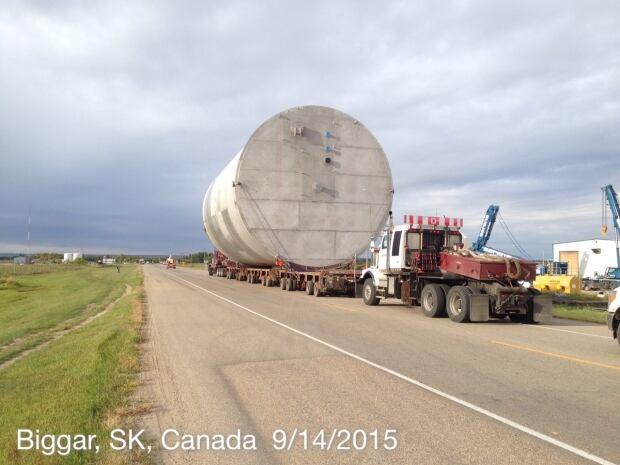 SaskPower moving big cylinder along highway