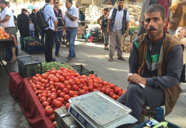 Syrian refugee sells produce in Kilis, Turkey