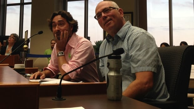 Dean Stamler, left, and Ken Shields attend Monday night's council meeting where a resolution to consider the cost of creating a new protected bike lane was passed