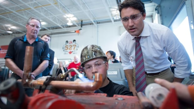 Liberal Leader Justin Trudeau toured a pipe fitting training facility during a campaign stop in Waterloo, Ont., on Sept. 15, 2015.