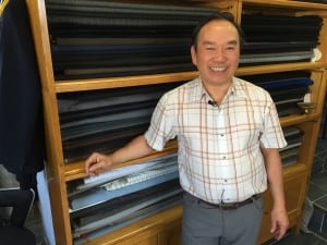 Tam Nguyen at his tailoring shop on Ellice Ave