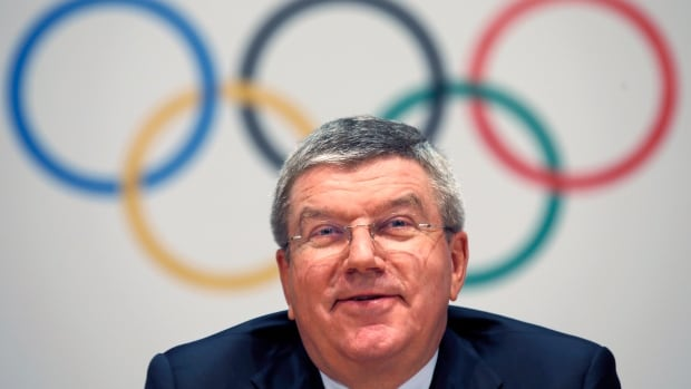 "IOC President Thomas Bach says his organization wants to ""send a message of hope for all refugees of the world."""