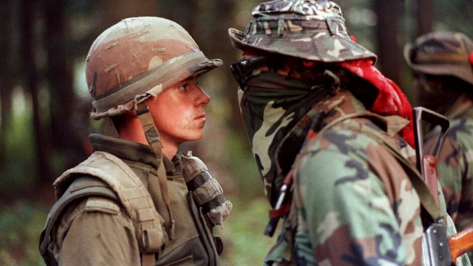 Canadian soldier Patrick Cloutier and protester Brad Laroque come face-to-face during a standoff at the Kanesatake reserve in Oka, Quebec on September 1, 1990.