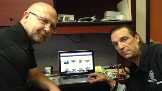 Joe MacGillivary (left) and Vince Rigby scroll through the website of a licenced marijuana provider Thursday at Marijuana for Trauma Inc.'s Sydney centre.