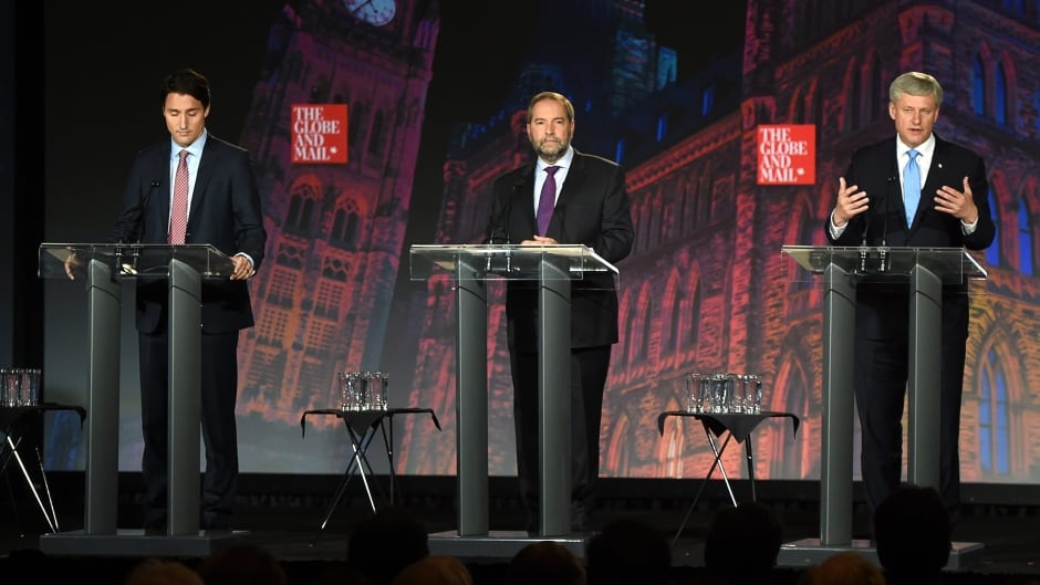Liberal Leader Justin Trudeau, left, NDP Leader Tom Mulcair and Conservative Leader Stephen Harper, right, take part in the Globe and Mail hosted  leaders' debate.