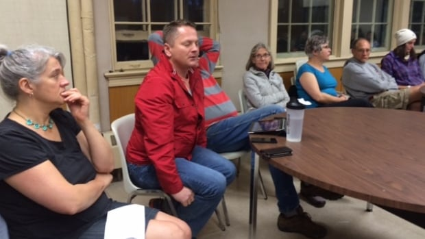City councillor Darren Hill speaks to City Park residents worried about losing their neighbourhood's Shop Easy grocery store, at a community association meeting last month.