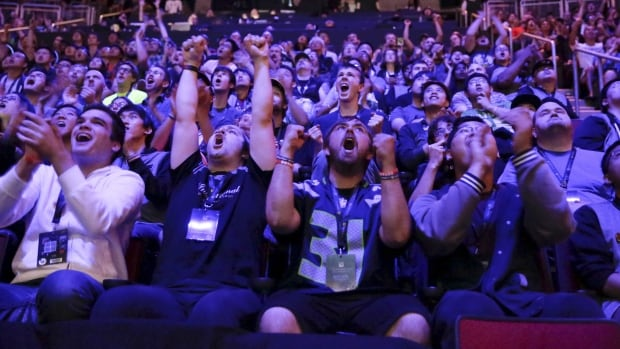 Fans react during The International Dota 2 Championships at Key Arena in Seattle, Wash. Cineplex is hoping to host a number of competitive gaming events to bring more bodies back to theatres.