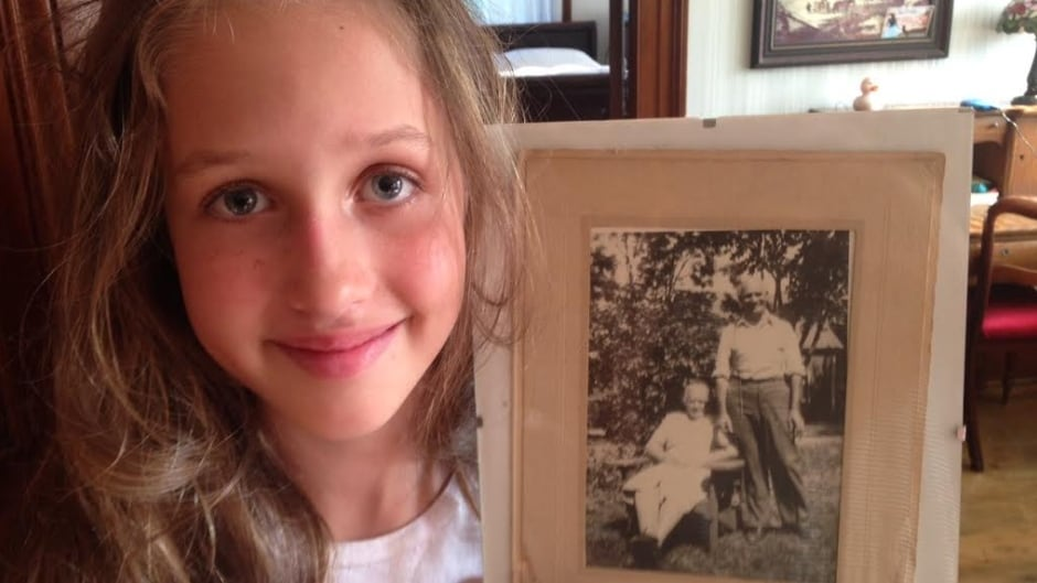 Laila Lynk Graham holding a photo of her great-grandparents, Dahabieh and Mahfouz Joseph (El-Rafieh).