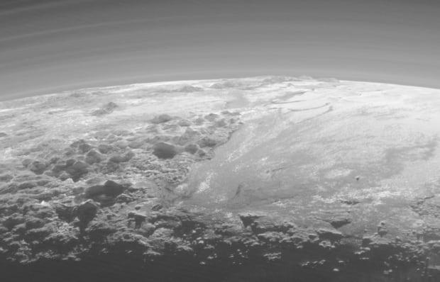Pluto backlit mountains plains
