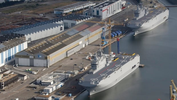 The two Mistral-class helicopter carriers Sevastopol (bottom) and Vladivostok are seen at the shipyard in Saint-Nazaire, western France, in May 2015. After France withdrew the vessels from sale to Russia, Canada was a potential customer.