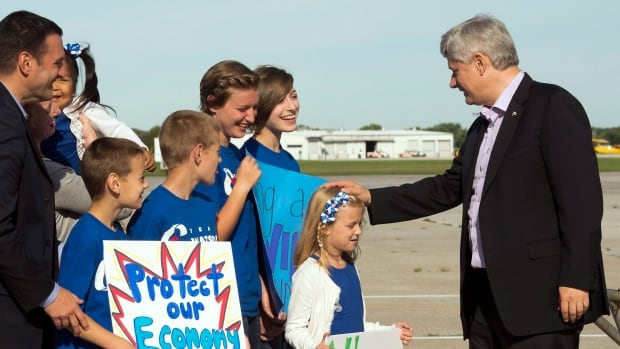 Conservative Leader Stephen Harper is greeted at the Windsor, Ont., airport by local candidate Jeff Watson and his family on Sunday morning.