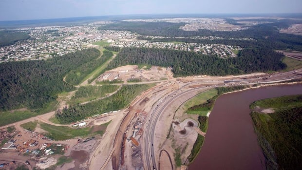 The Athabasca River, highway construction and suburbs seen from a helicopter in Fort McMurray, Alta., on July 10, 2012. Water for the oilsands industry comes mainly from northern Alberta's Athabasca River, and oilsands account for 72 per cent of estimated water use from the river.