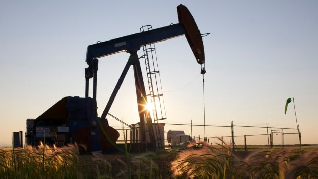 An oil pump jack pumps oil in a field near Calgary on July 21, 2014, when oil was trading about $100 per barrel. The province's economy has been battered as oil crashed over the ensuing two years, but should return to growth in 2017, says BMO.