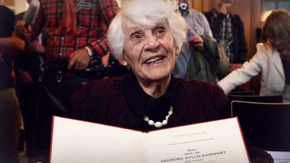 Retired German neonatologist Ingeborg Syllm-Rapoport, aged 102, poses with her doctoral certificate at the UKE hospital in Hamburg, June 9, 2015. From 1937 until 1938 Syllm-Rapoport studied medicine in Hamburg, but the admission to her oral exam was denied by the Nazi authorities due to her Jewish origin. Some 77 years later Syllm-Rapoport took her oral exam and passed it successfully on May 20, 2015.