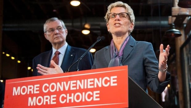 Government adviser Ed Clark and Premier Kathleen Wynne say the rollout of beer sales in grocery stores is being done in a socially responsible way.