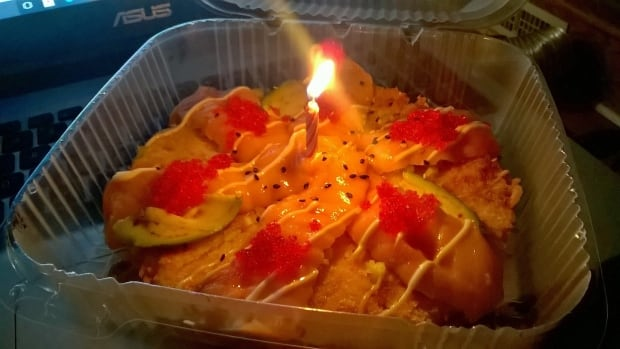After a Halifax sushi restaurant received an online order from a man who was having a hard month, the staff put together a special birthday delivery — complete with a candle on a sushi pizza.
