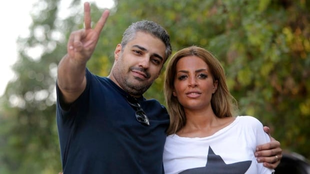 Canadian Al Jazeera journalist Mohamed Fahmy hugs his wife Marwa Omara after being released from Torah prison in Cairo on Sept. 23. Fahmy left Egypt on Tuesday.