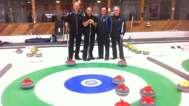 The triumphant team standing with their extraordinary eight-ender at the Langley Curling Club.